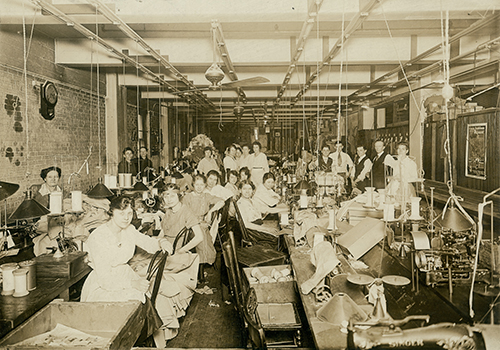 Seamstresses at their stations in the Consolidated Garment Company sewing workshop