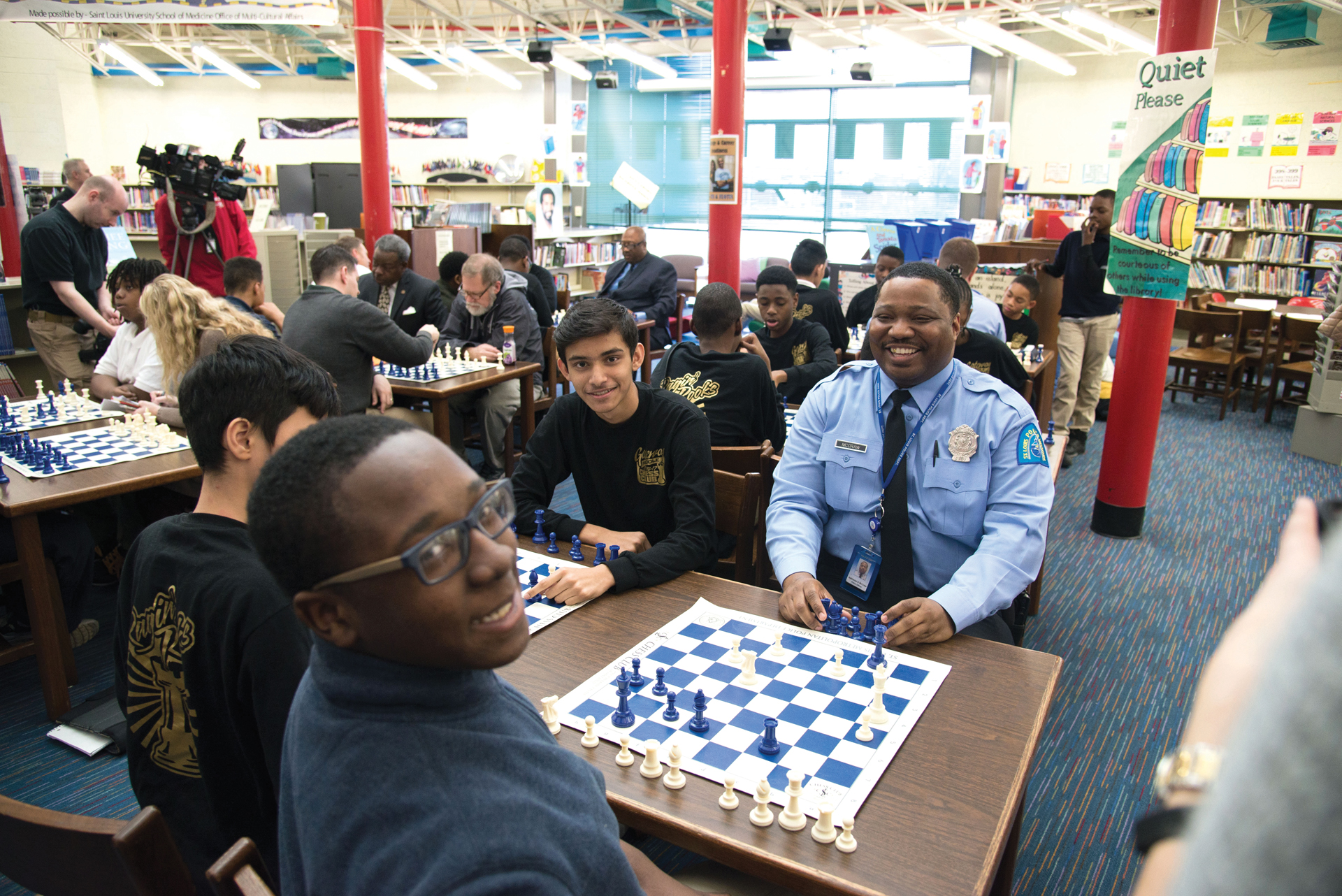 Officer Nate McGraw enjoying a chess game with St. Louis Public School students.